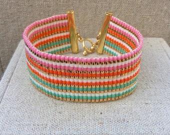 Large green and pink Bracelet: a machete miyuki weaving