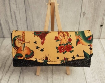 Tattoo inspired Alexander Henry purse