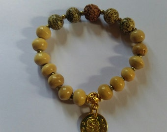 Handmade wood and stone bead with charm bracelet.