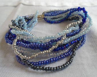 Bracelet en rocailles tons dégradés de bleu