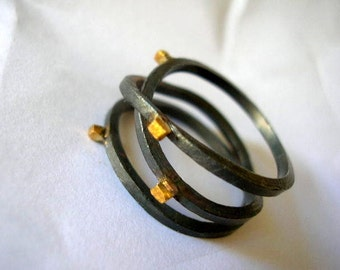 oxidized sterling silver infinity ring with gold plated square dots. Triplet ring