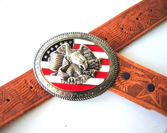Americana vintage 80s. rust-brown, genuine leather tooled belt with silver tone metal, oval shape buckle , eagle , americal flag.Size 36-45