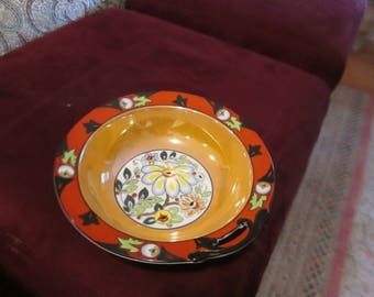 Bowl oranges and black with a central floral motif,, Made in Japan, hand painted 1930's