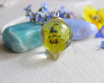 Resin inlaid with a yellow pansy flower Teardrop Pendant