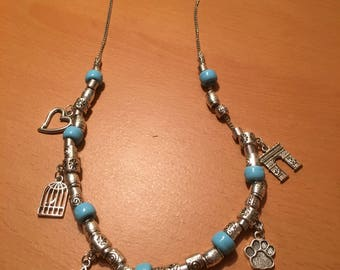 Handmade beaded necklace made of metal beads,charms and blue beads on a metal chain