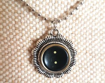 Black full stop or period symbol necklace with flower surround/ typewriter key pendant / silvertone flower pendant