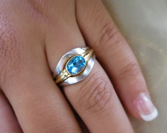 14K two tone Blue topaz gold ring.