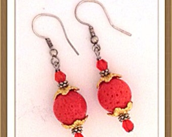 Handmade MWL orange dangle earrings. 0139