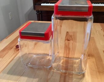 Set of two Kitchen Canisters- Perfect for any Retro Mid Century Kitchen! Glass w/ Red and silver lids
