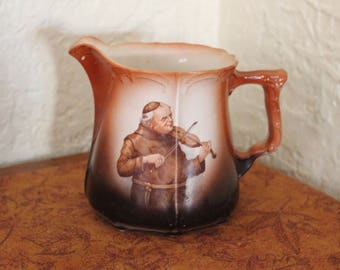 Vintage S.P. C0. Monk Porcelain Musician Milk Pitcher