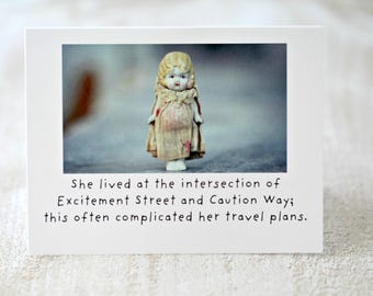 """Adventures of Claudia China Doll Stationary Silly Card """"Intersection"""" Typography Funny Notecard Travelling Dolly"""