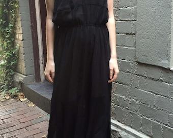Space between long sheer black dress