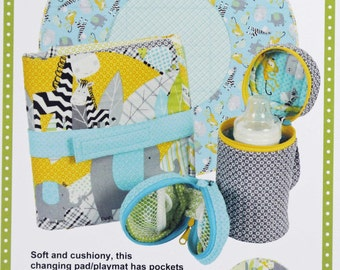 By Annie Baby Travel Accessories Sewing Pattern, Baby Gifts, Baby Shower, Bottle Carrier, Pacifier Pouch, Playmat, Changing Pad