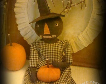 Primitive Harvest Witch Doll Holding Pumpkin