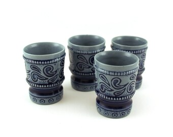 Vintage set of four shot glasses eggshell blue colour and  dark blue pattern