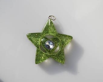 Plastic pendant 57 mm Green glitter star