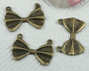 6 charms in antique bronze bow connectors