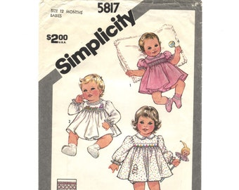 "Vintage Simplicity children's sewing pattern #5817, ""Babies' Plain or Smocked Dress and Panties (with transfers)"", size 12 months, 1982."