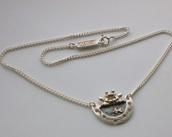 Looking after the little ones,silver frog and tadpole necklace
