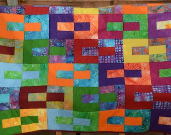 Multi-coloured handmade quilt for single bed