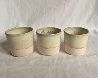 Trio of pink porcelain shot beakers