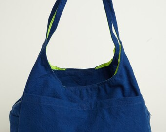 The B.Wellborne Primo Bag in Blue with neon yellow liner