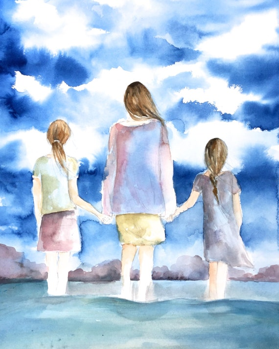 mother and and two daughters by the ocean