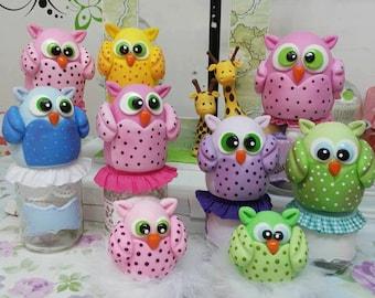 Bottles with porcelain owls