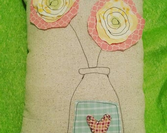 Applique and stitched flower pillow.
