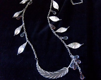 Gorgeous silverplated leaves and faceted teardrop glass beads in clear and blush on a beautiful silverplated chain.