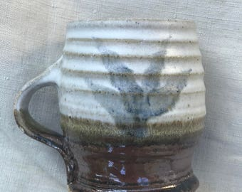 beautiful handmade ceramic mug with leaf detail