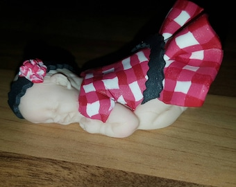 1 baby gingham dress has a Fimo flower