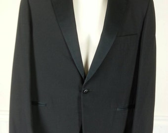 Black tuxedo with satin stripe and buttons for suspenders size 41 regular chest 44in. pants 38in. waist