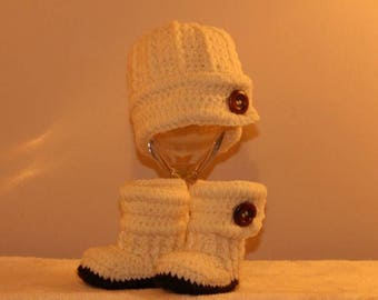 Cream baby boy hat and bootie set.