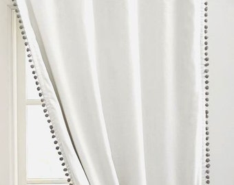 One shade of Gray Pom Pom Curtain