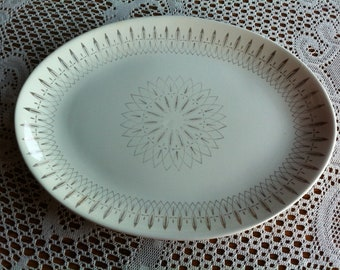 An Oval Porcelain Platter With An Atomic Design/Look