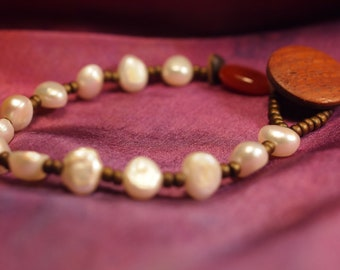 pearl beaded bracelet with seed beads and carnelian end bead