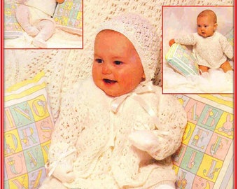 9-piece layette with its delicate lacy and moss stitch pattern/Shawl,Dress,Matinee Jacket,Angel Top,Vest,Tights,Bootees, Mitts,Bonnet/P- 945