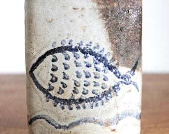Ceramic stoneware with a mid century fish motif