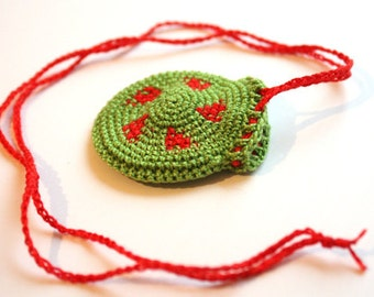 Crochet Drawstring Jewelry Holder, grass green with red geometric design, crochet bag, little pendant,necklace purse,totem saver,round purse