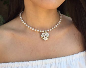 Pearl necklace with vintage 1960s tri-flower pendant