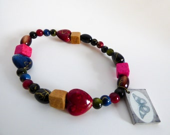 Glass and Wooden Bead Stretch Bracelet With Butterfly Charm