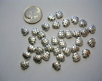 Metal leaf beads Antiqued Silver 7mm 50 beads double sided 3mm thick 1mm hole leaves charms