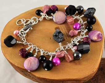 Pink and Black gemstone chunky cha cha bracelet chock full of different gorgeous stones and it's adjustable too!