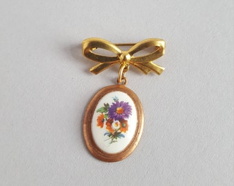 Brass bow and floral charm vintage brooch pin