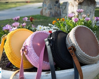 Round crochet and leather zip crossbody bag