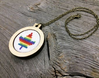 Rainbow maple leaf cross stitch necklace in wood hoop pendant on bronze tone chain by Canadian Stitchery
