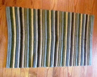Rag rug.Woven greens and browns stripes pattern.Oblong