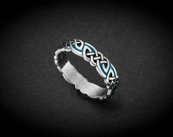 Sterling silver ring with a unique Tribal design inlaid with Turquoise Size: 6.5 thru 13