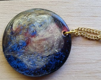 Necklace: blue, gold, red round resin pendant on golden chain; gift for her